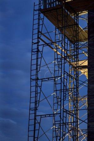 Construction scaffolding, nighttime