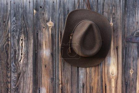 Felt cowboy hat on barn wall
