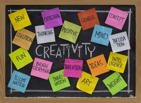 Photo for Creativity concept - related cloud of words, color sticky notes and white chalk handwriting on blackboard - Royalty Free Image