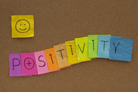 Photo for Positivity concept on cork bulletin board - colorful sticky notes with a smiley - Royalty Free Image