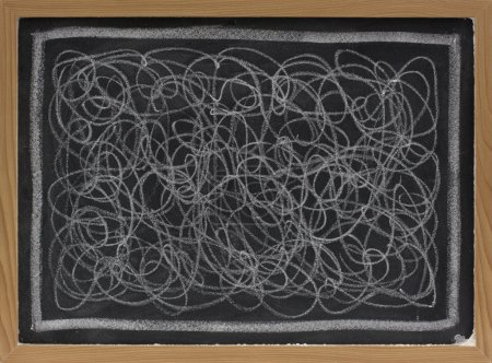 White chalk scribble on blackboard