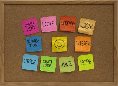 Photo for Positive emotions concept - color sticky notes around smiley on cork bulletin board - Royalty Free Image