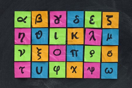 Photo for Greek alphabet (lower case) - handwriting on colorful sticky notes posted on blackboard with white chalk texture - Royalty Free Image