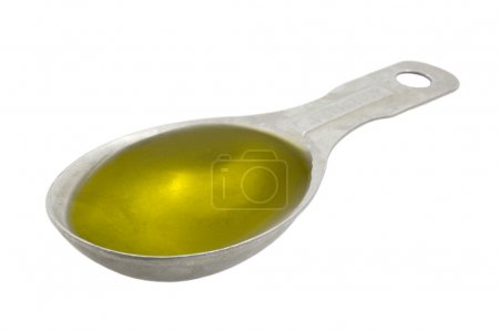 Measuring tablespoon of olive oil