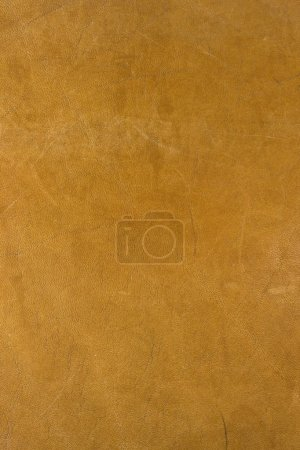 Photo for Scratched and stained yellow leather background from old, well worn, bag - Royalty Free Image