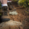 Hiker feet in heavy hiking boots on a mountain or ...