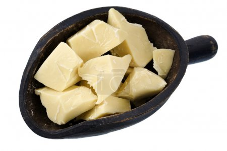 Photo for Rough chunks of white chocolate on a primitive, wooden scoop, isolated - Royalty Free Image