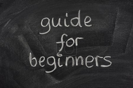 Photo for Guide for beginners title handwritten with white chalk on a blackboard - Royalty Free Image