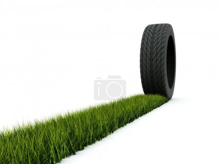 Tire with track from grass isolated on w