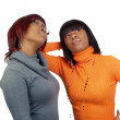 Young black women in orange and grey sweaters...