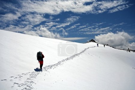 Climbers at the snow slope in Caucasus