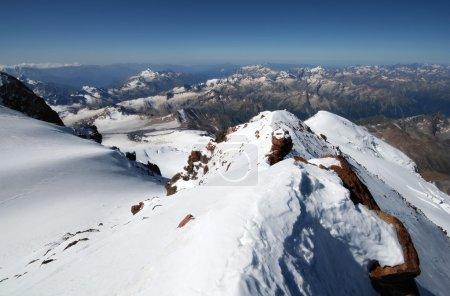 Snow rocks in mountains from peak Elbrus