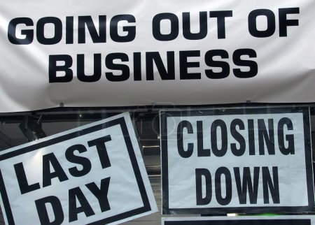 Photo for Closing down signs in high street shop window - Royalty Free Image