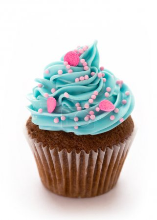Photo for Chocolate cupcake decorated with blue frosting and pink sugar sprinkles - Royalty Free Image