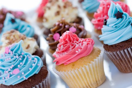 Photo for Assortment of brightly colored cupcakes - Royalty Free Image
