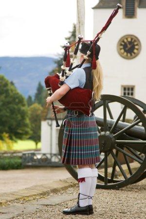 Scottish bagpiper outside Blair Castle