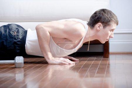 Man Doing Push-ups in Living Room