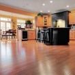 Home interior shows a large expanse of wood floori...