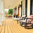 Low angle view of a large front porch with furnitu...