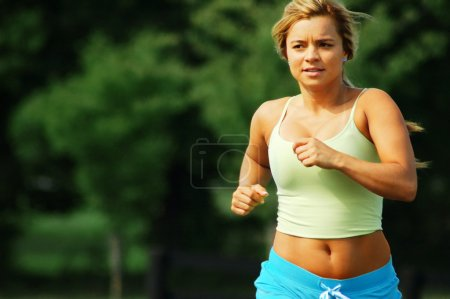 Photo for Beautiful girl jogging on a summer day. - Royalty Free Image