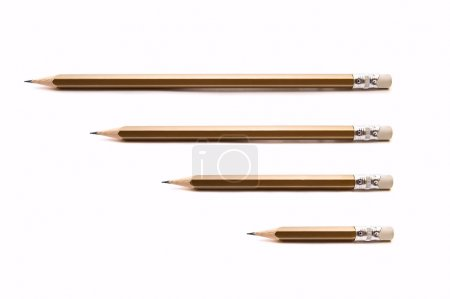Photo for Four pencils different size on white background - Royalty Free Image