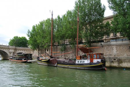 Private yacht and ship at Seine bank