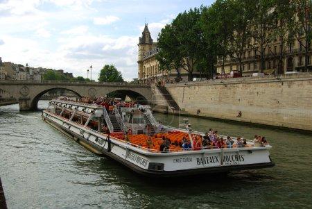 Tourist ship on Seine river in Paris