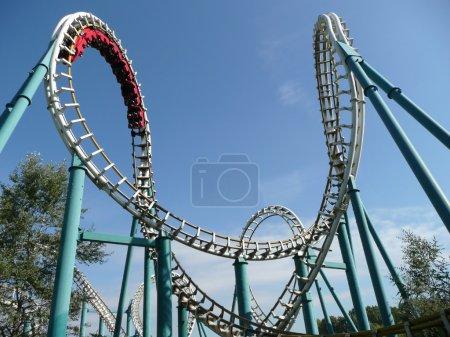 Rollercoaster in amusement park in summer...