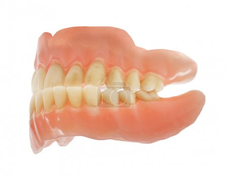 Old worn and dirty dentures isolated on white...