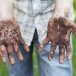A Man showing dirty hands after gardening work...