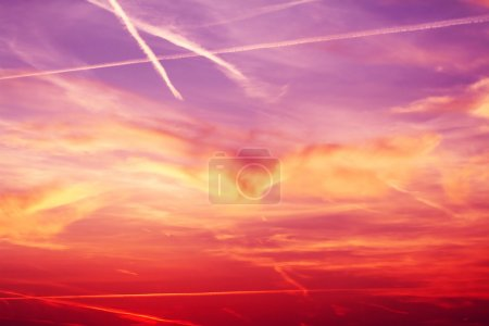 Photo for Airplane vapor trails forming a Letter A, enough space next to it for adding text. Central cloud formation somewhat resemble to an Eagle with spread wings... - Royalty Free Image