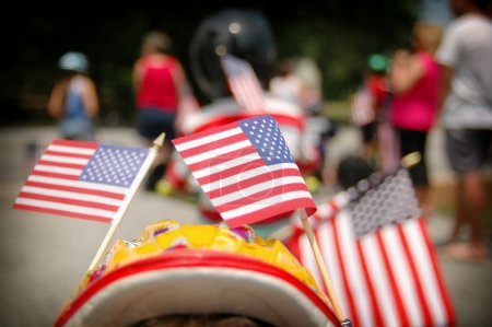 Photo for 3 American flags in a parade - Royalty Free Image