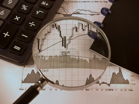 Photo for Black Calculator, paper, notebook, magnifying, analyzing, accounting, stock graph - Royalty Free Image