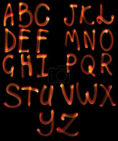 Photo pour L'ensemble, l'alphabet abc sur fond noir, est isolé. - image libre de droit