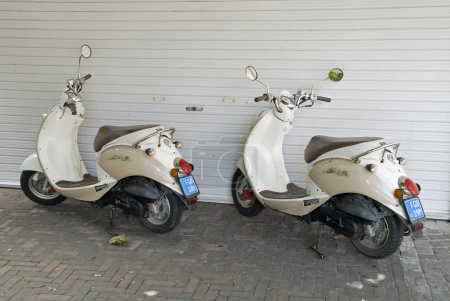Two parked scooters