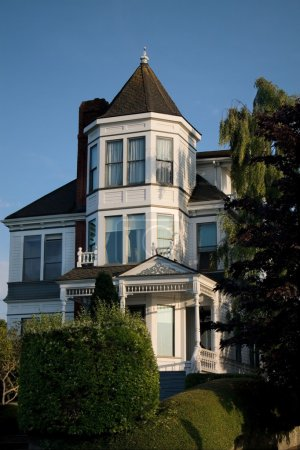 White Victorian Home on Hill