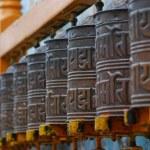 Tibetan Buddhism prayer wheels in a row...