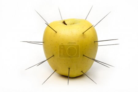 Spiked apple isolated on white