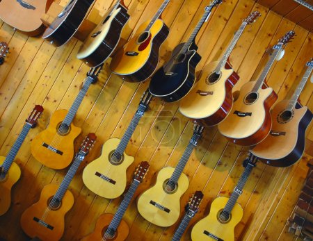 Photo for Guitars on a show-window in shop of musical instruments - Royalty Free Image