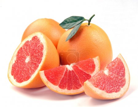 Photo for Grapefruit with segments on a white background - Royalty Free Image