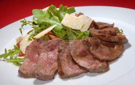 Boiled beef with rukkola