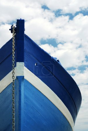 White and blue wooden boat