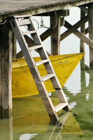 Yellow boat under the dock