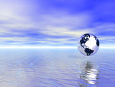 Abstract glass globe over blue ocean