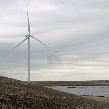 Wind turbine on an artificial dyke