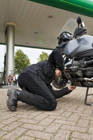 Motorist, checking the oil level