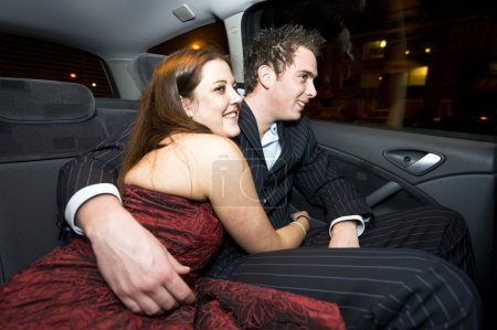 Young lovers in the backseat
