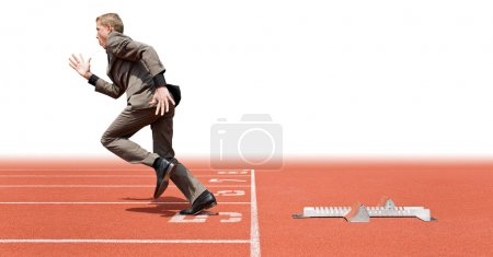 Photo for Businessman leaving the starting blocks - a metaphor of starting a new business, off on a good start - Royalty Free Image