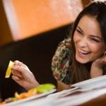 Cheerful girl at table...