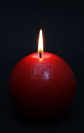 Red round shining candle